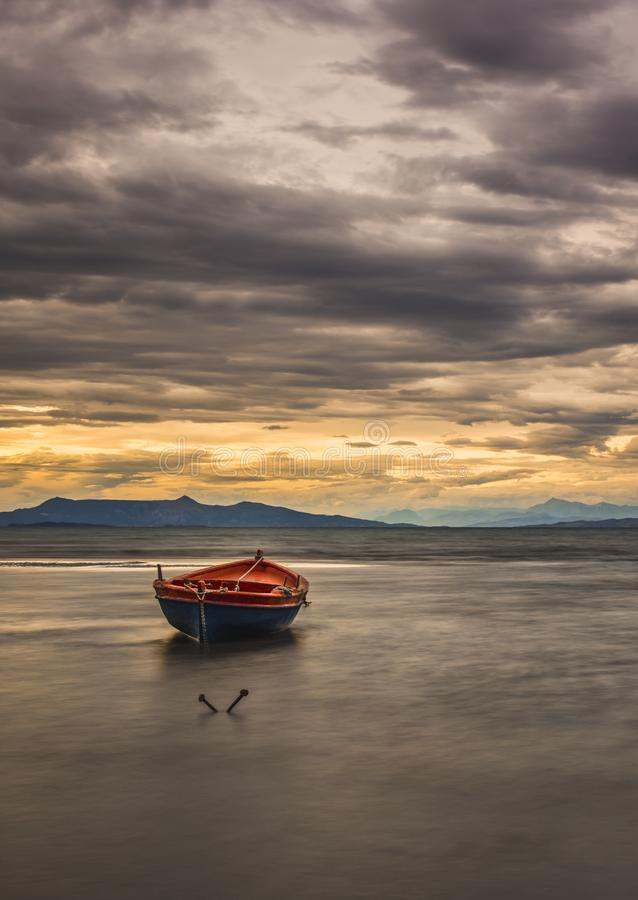 Long exposure shot of an isolated boat at sunset. Greece stock image