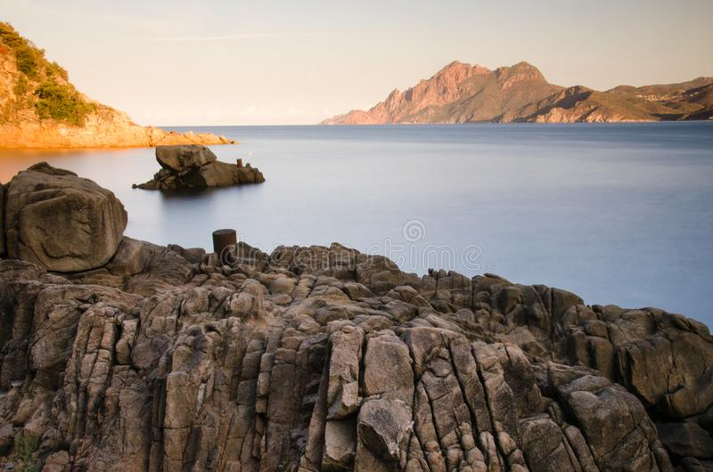 Sunrise at Gulf of Porto and Scandola Nature Reserve in Corsica, France royalty free stock images