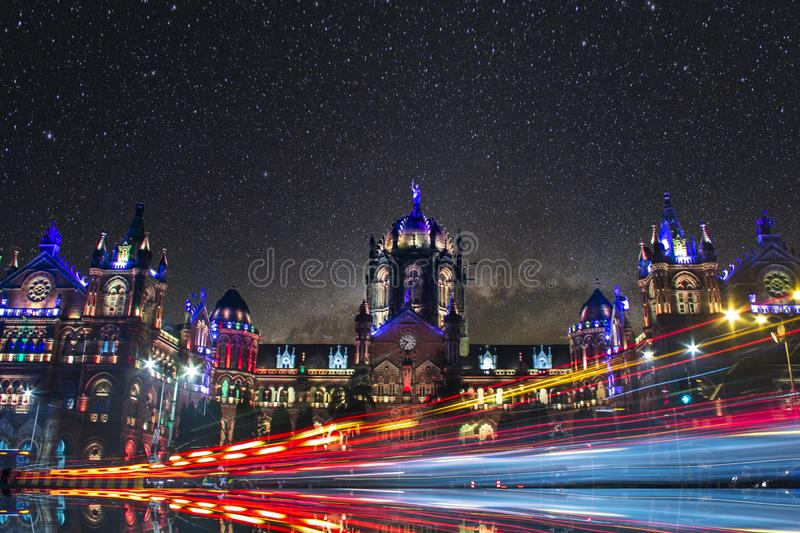 Long exposure shot of vehicle light trails with milkyway and Iconic structure in background. Focus on lights. Mumbai. India. Iconic destination of Mumbai. Long stock image