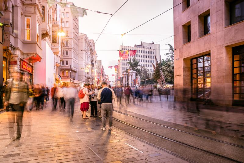 People walk at Istiklal street in Istanbul. Long exposure or slow shutter speed and blurred image:Unidentified people walk at Istiklal street,popular destination royalty free stock photography