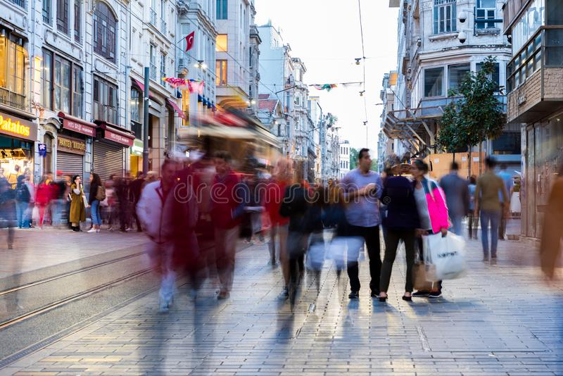 People walk at Istiklal street in Istanbul. Long exposure or slow shutter speed and blurred image:Unidentified people walk at Istiklal street,popular destination royalty free stock photo