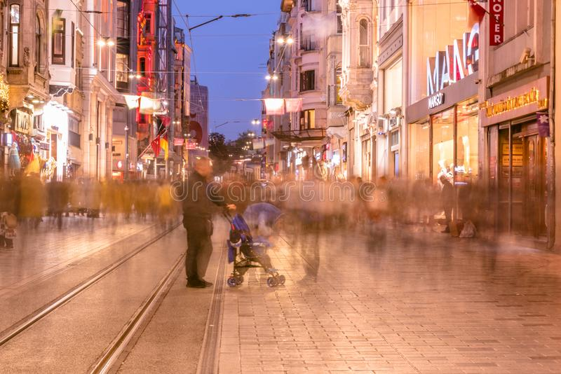 People walk at Istiklal street in Istanbul. Long exposure or slow shutter speed and blurred image:Unidentified people walk at Istiklal street,popular destination royalty free stock photos