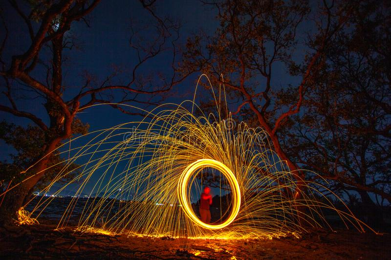 long exposure speed motion abstract of steel wool at twight stock images
