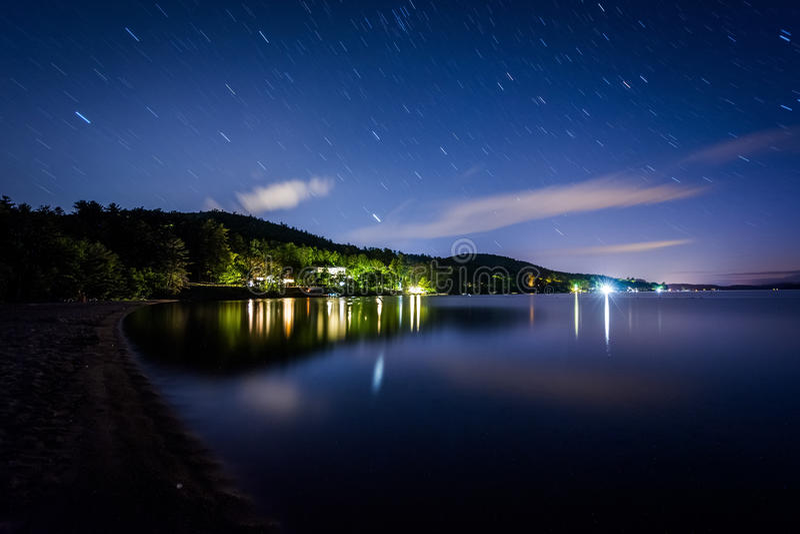 Long exposure of stars moving over Lake Winnipesaukee at night, stock photo