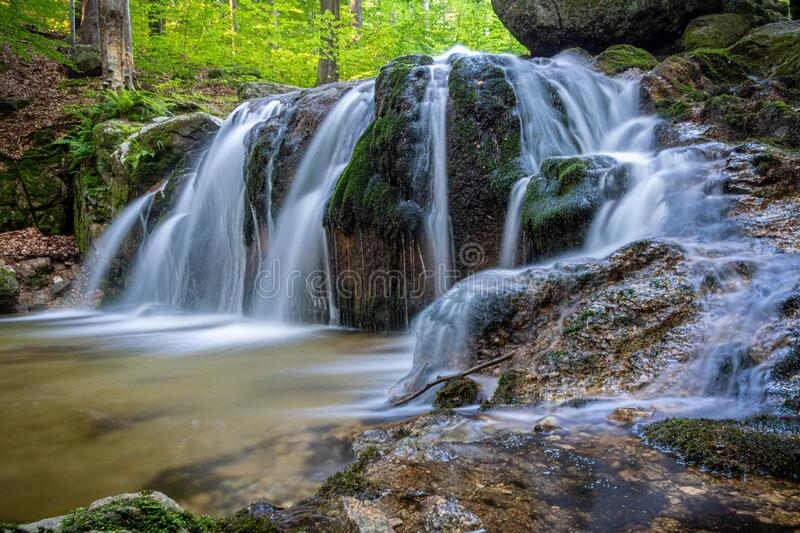 Long exposure of stream waterfalls in summer forest stock photography