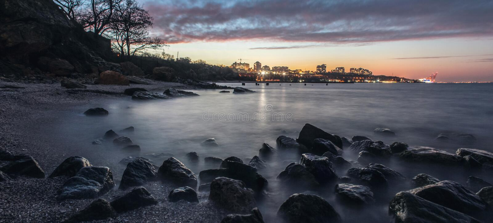 Long exposure of a stunning rocky beach in Odessa at dusk. royalty free stock images