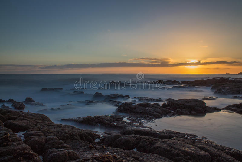 Long Exposure Sunrise at Greyhope Bay stock photo