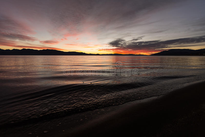 Long exposure during sunrise. Over a large lake royalty free stock images