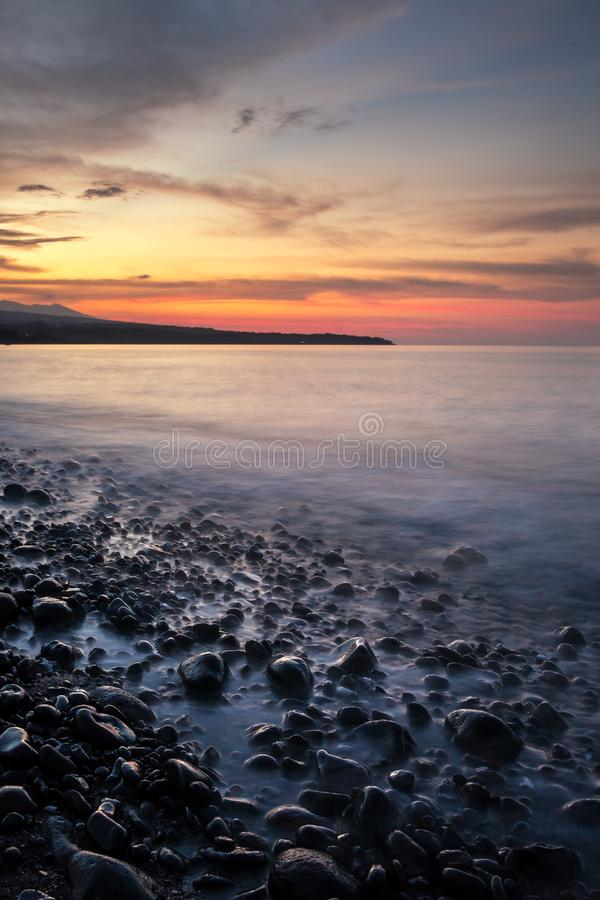 Long exposure sunset photo at Amed beach royalty free stock image
