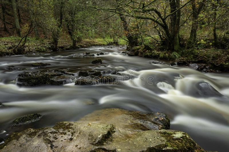 Taf Fechan River. Long Exposure of the Taf Fechan River `Running Wild` within the Taf Fechan Forest, Brecon Beacons National Park, Mid Wales, United Kingdom stock image
