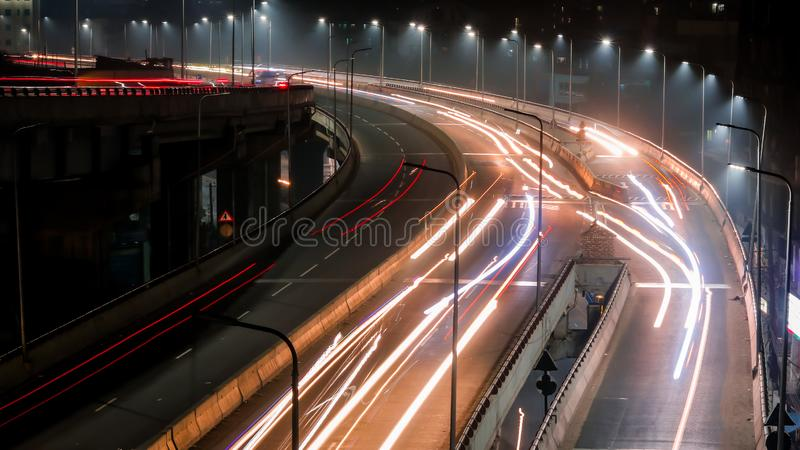 Long exposure shot of traffic and cars lights time lapse. Long exposure traffic and cars lights time lapse in night city stock photo