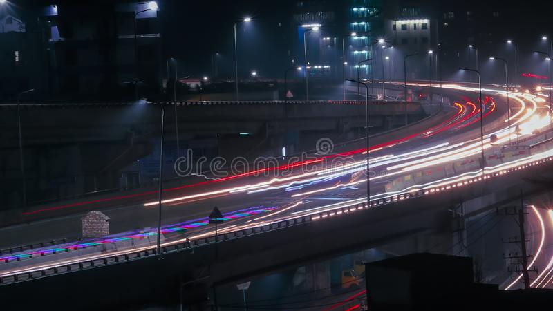 Long exposure shot of traffic and cars lights time lapse. Long exposure traffic and cars lights time lapse in night city royalty free stock image