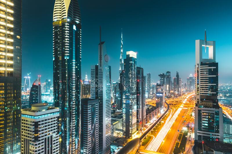 Long exposure view of traffic and skyline from rooftop at night Dubai - UAE.  stock image