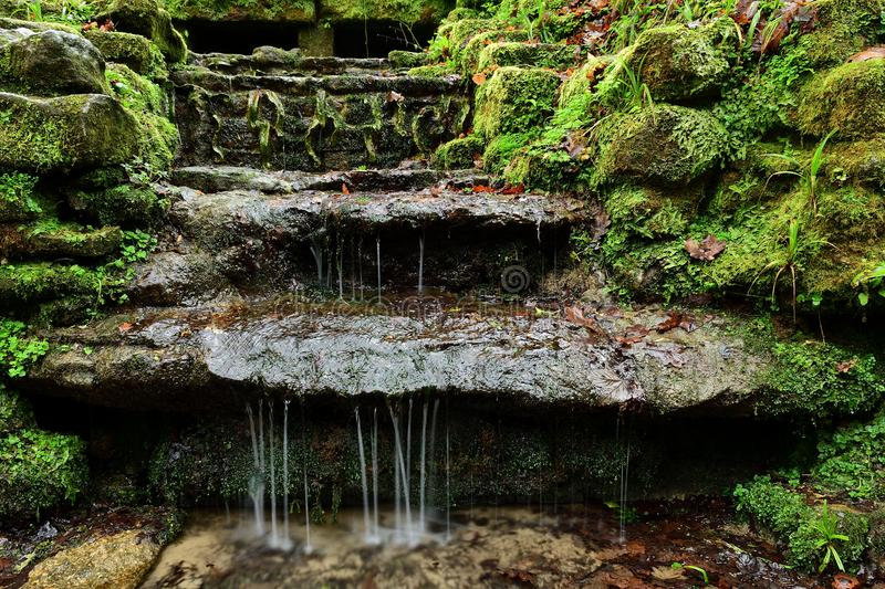 Ninesprings park in Yeovil in Somerset. Long exposure of water trickling down stone steps in Ninesprings park in Yeovil in Somerset stock image