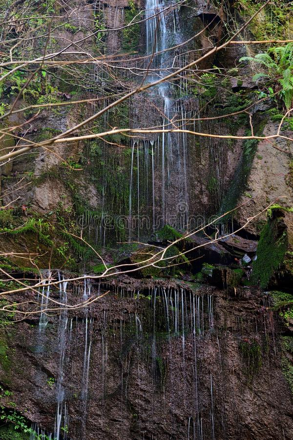 Waterfall trickling down a cliff. Long exposure of a waterfall trickling down the side of a cliff royalty free stock photos