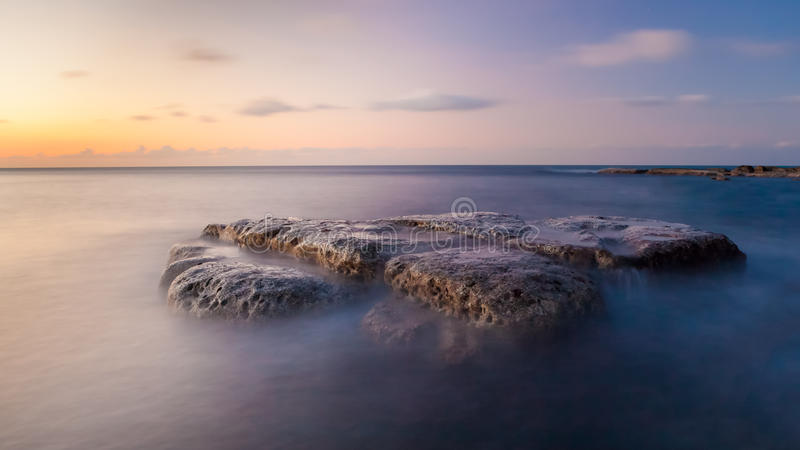 Long exposure waterscape and rock stock photography