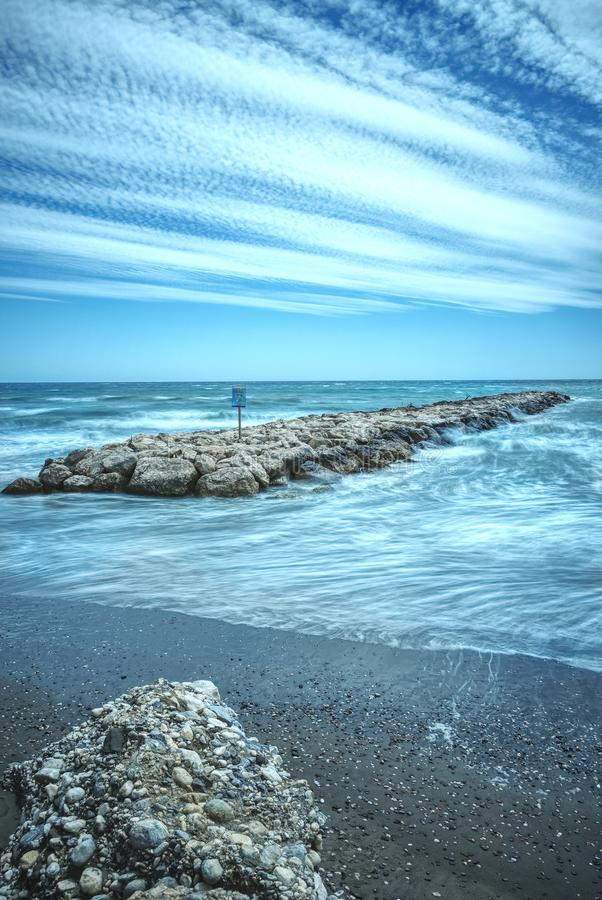 Long exposure, waves against breakwater, Torrox Costa, Southern Spain. stock photography