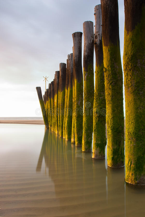 Long exposure wooden breakwater photo. Calais royalty free stock images