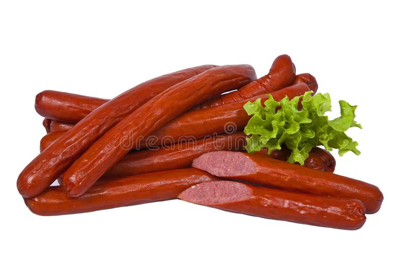 Long and fatty sausages with salad leaf. Isolated on white background royalty free stock photo