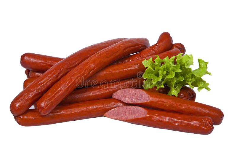 Long and fatty sausages with salad leaf. Isolated on white background stock image