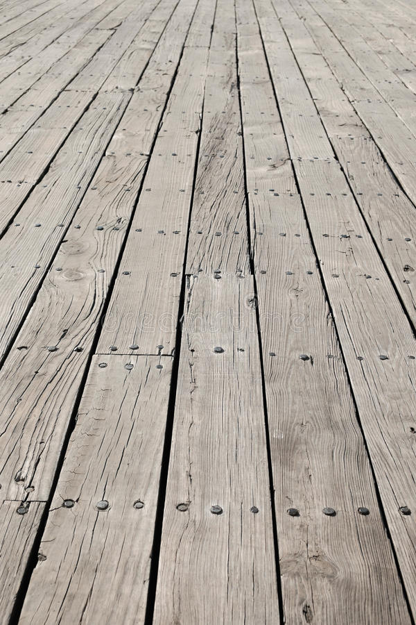 Long flat timbers of a new deck on a working dock on the New Eng. Land Coast stock photo