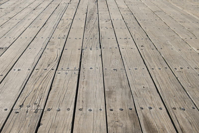 Long flat timbers of a new deck on a working dock on the New Eng. Land Coast stock images