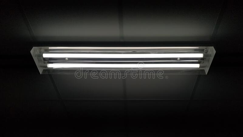 Long fluorescent light lamp under the ceiling In the building. stock image