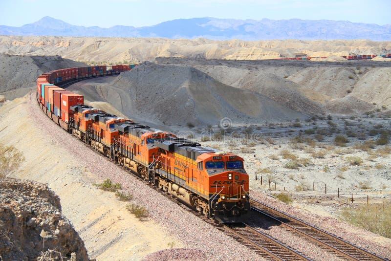 USA, California/Mojave Desert: Long BNSF Freight Train. A BNSF (Burlington Northern - Santa Fe) train in the Mojave Desert on a track that runs parallel to stock image