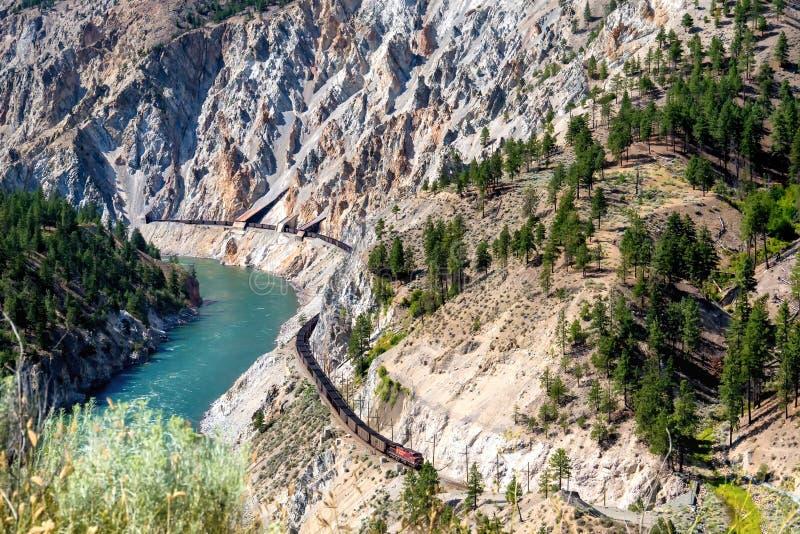 Long freight train snakes along the precipitous Thompson Canyon stock photos
