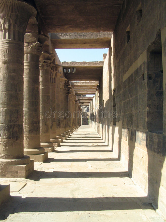 Long gallery at Temple of Philae, Egypt. Long gallery at Temple of Philae, near Aswan, Egypt royalty free stock photos