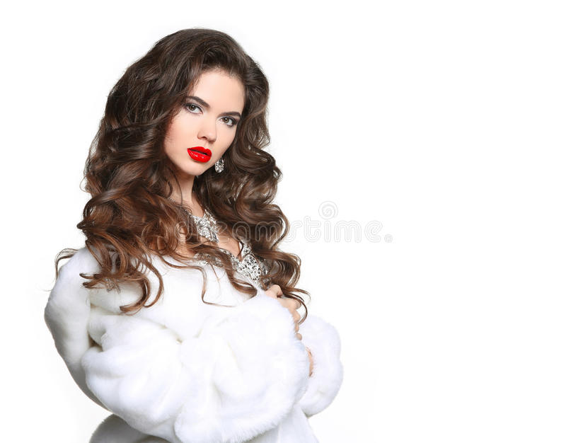 Long hair. Beautiful Woman in Luxury white mink Fur Coat. Fashion jewelry accessories. Beauty Makeup. Elegant lady isolated on stock images