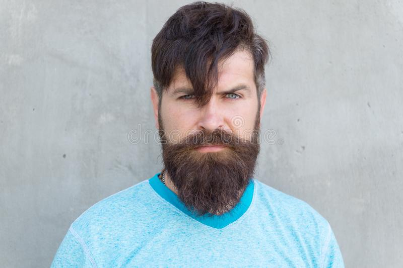 Long hair. Cut bangs. Cool hipster with beard need haircut. Barber salon and facial care. Hipster lifestyle. Brutal stock photo