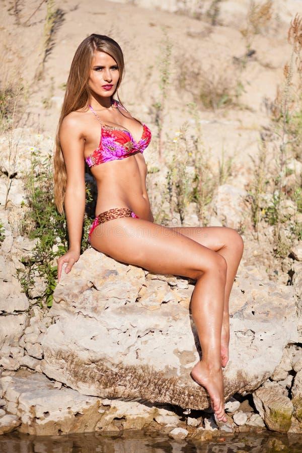 Long hair girl in bikini on river stock image