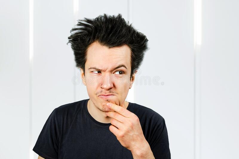 Long hair guy offended and matures on a white background.  royalty free stock photography