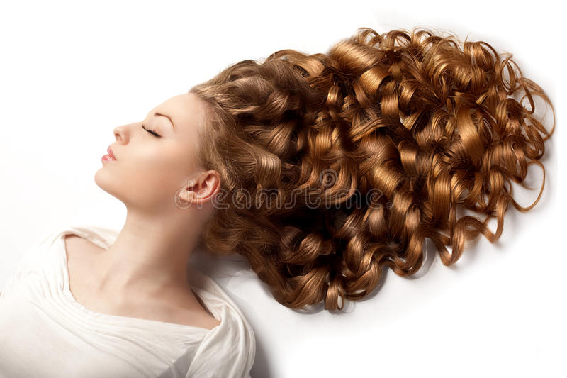 Long hair. Waves Curls updo hairstyle in salon. Fashion model, w stock photos