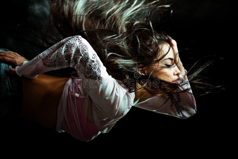 Long hair woman flying through the night royalty free stock photos