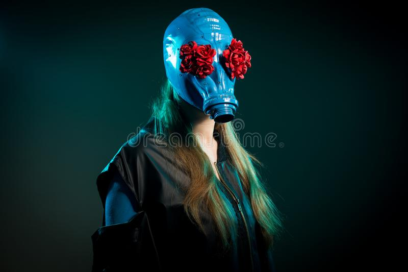 Long haired girl in a blue gas mask stock photo