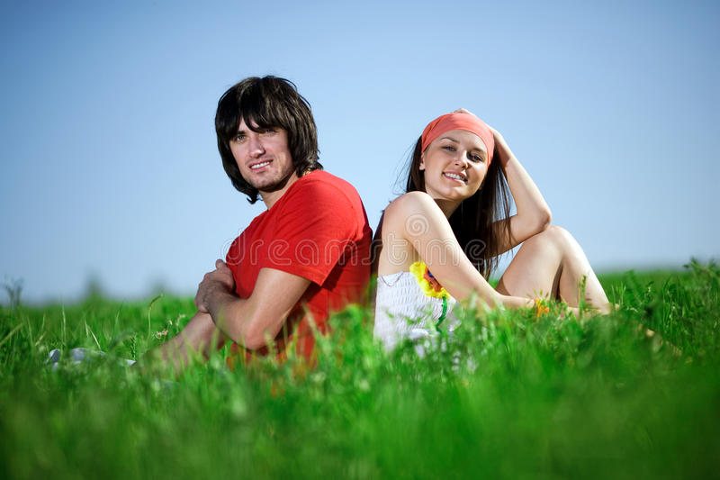 Download Long-haired Girl With Boy On Grass Stock Photo - Image of love, cheerful: 14831002