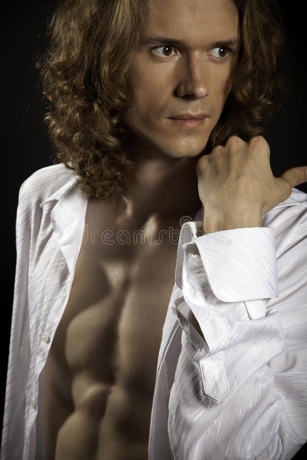 Long-haired handsome man with naked torso