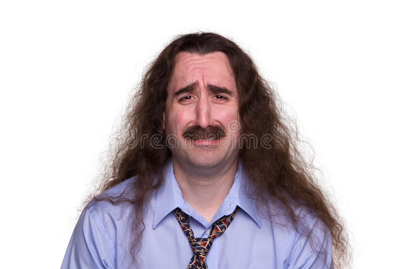 Long Haired Man Crying1. A sad long haired man crying with tears streaming down his face royalty free stock photography