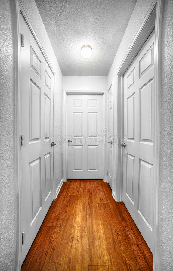 Long Foyer Xl : Long hall with four doors stock image of wide