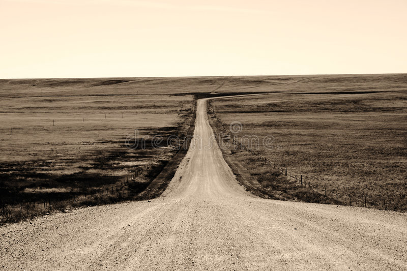 Long Hard Road. This was shot on the road to my parents house in Cheyenne, WY royalty free stock images