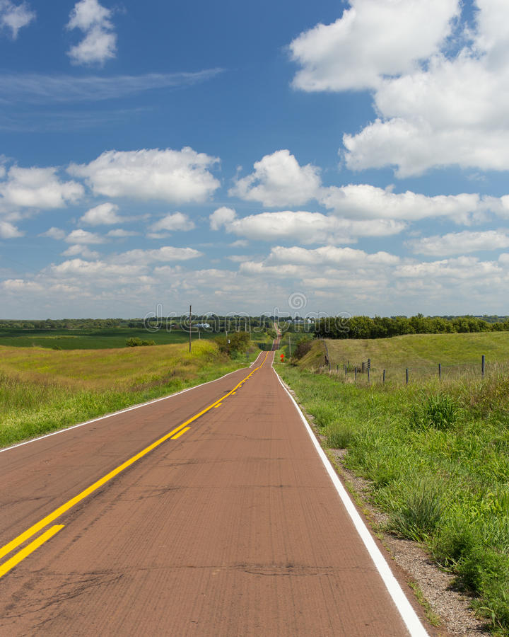 Long and hilly country road stock photos