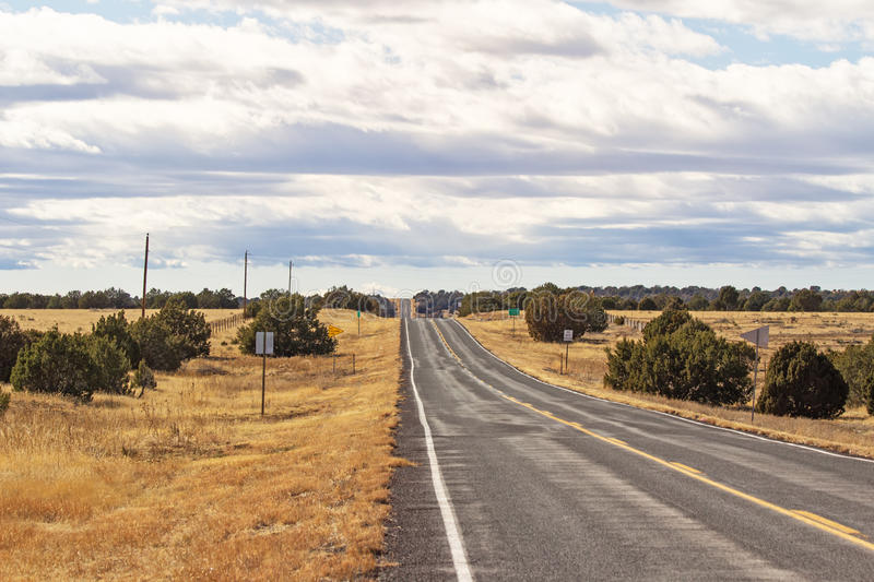 Long hilly highway in New Mexico royalty free stock image