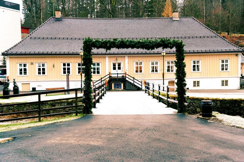 Long historical building. The old office in the former iron foundry, on the river Lomma. Norwegian Christmas decorations around a sheaf of grain. Norwegian stock image