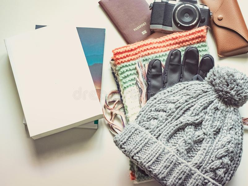 Long holiday and winter season travel flat lay concept from winter cloth item and passport , retro camera , sunglasses and book p. Ut on white background royalty free stock photo