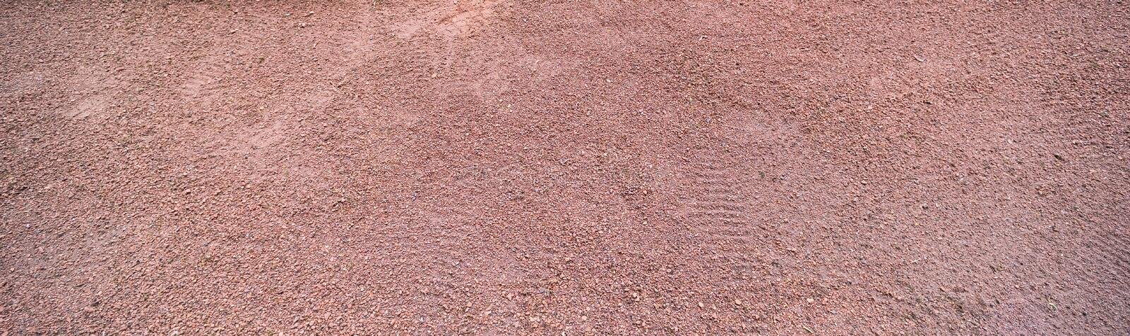 Long horizontal red sand surface with shoe prints. On top, nature, dry, background, texture, desert, textured, abstract, outdoor, brown, rough, natural, land royalty free stock photos