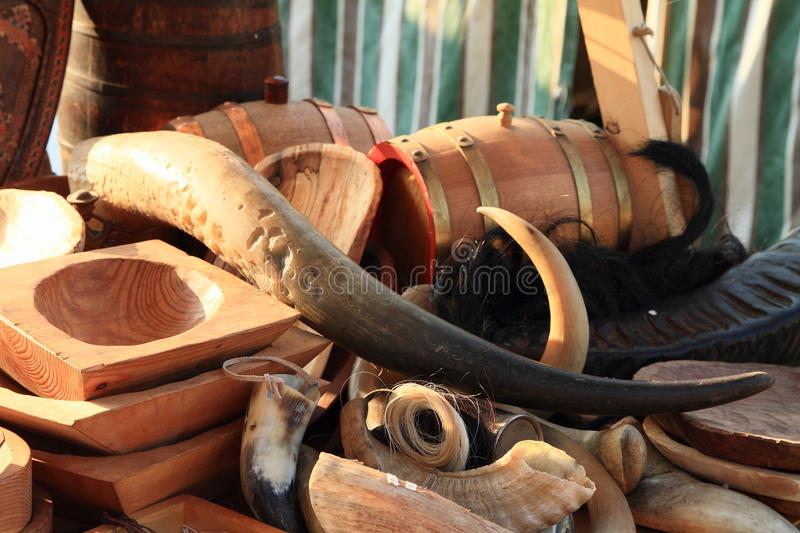 Long horn. Among small horns, wooden porringers and small barrels stock images