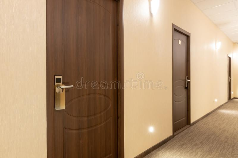 Long hotel corridor accent on the door stock photography
