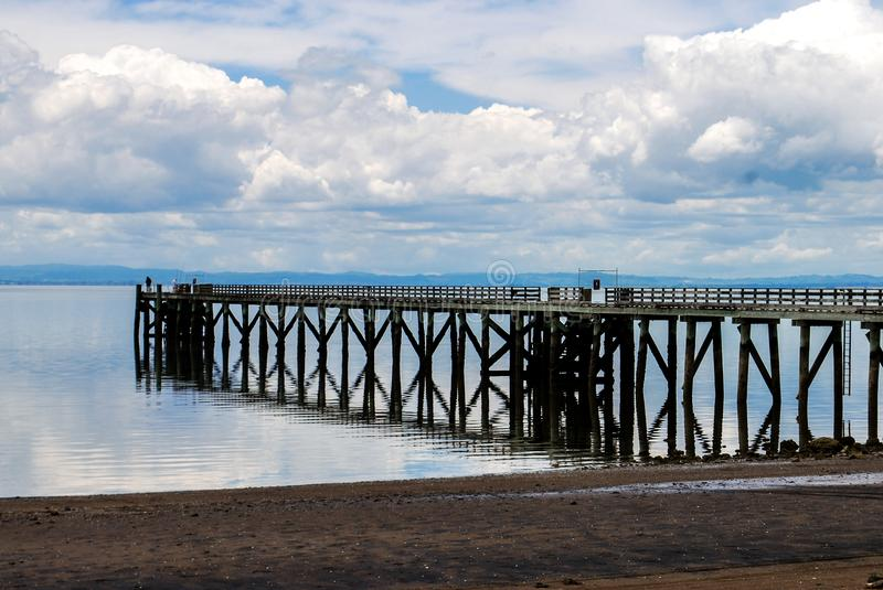 Long jetty on the beach. In New Zealand stock photo